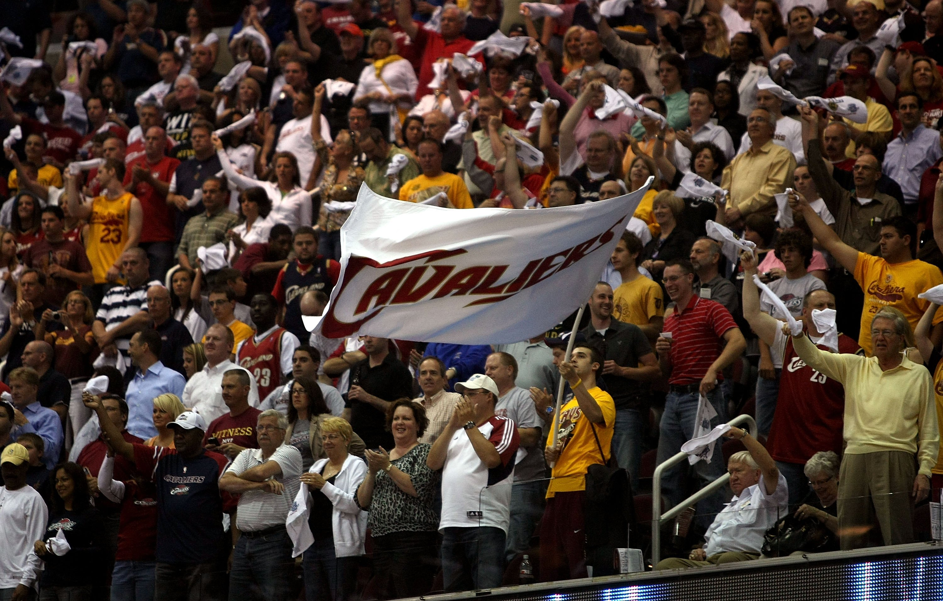CLEVELAND - MAY 28: Fans wave a Cavaliers flag during Game Five of the Eastern Conference Finals between the Cleveland Cavaliers and the Orlando Magic  during the 2009 Playoffs at Quicken Loans Arena on May 28, 2009 in Cleveland, Ohio. NOTE TO USER: User