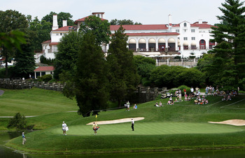 POTOMAC, MD - JUNE 28:  A general view as players putt on the 18th green of the Blue Course during British Open Championship Final Qualifying on June 26, 2004 at Congressional Country Club in Potomac, Maryland.  (Photo by Jamie Squire/Getty Images)