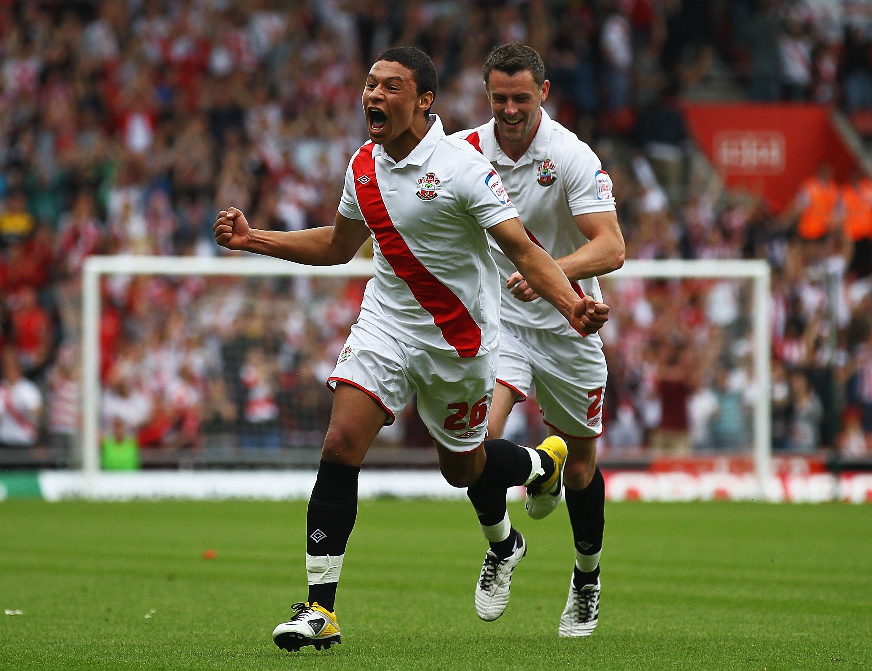 SOUTHAMPTON, ENGLAND - MAY 07:  Alex Chamberlain (L) of Southampton celebrates his goal with team mate Frazer Richardson during the npower League One match between Southampton and Walsall at St Mary's Stadium on May 7, 2011 in Southampton, England.  (Phot