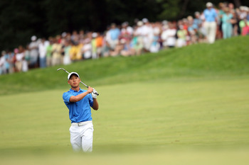 BETHESDA, MD - JULY 05:  Anthony Kim watches his shot during the final round of the AT&T National hosted by Tiger Woods at Congressional Country Club on July 5, 2009 in Bethesda, Maryland.  (Photo by Hunter Martin/Getty Images)