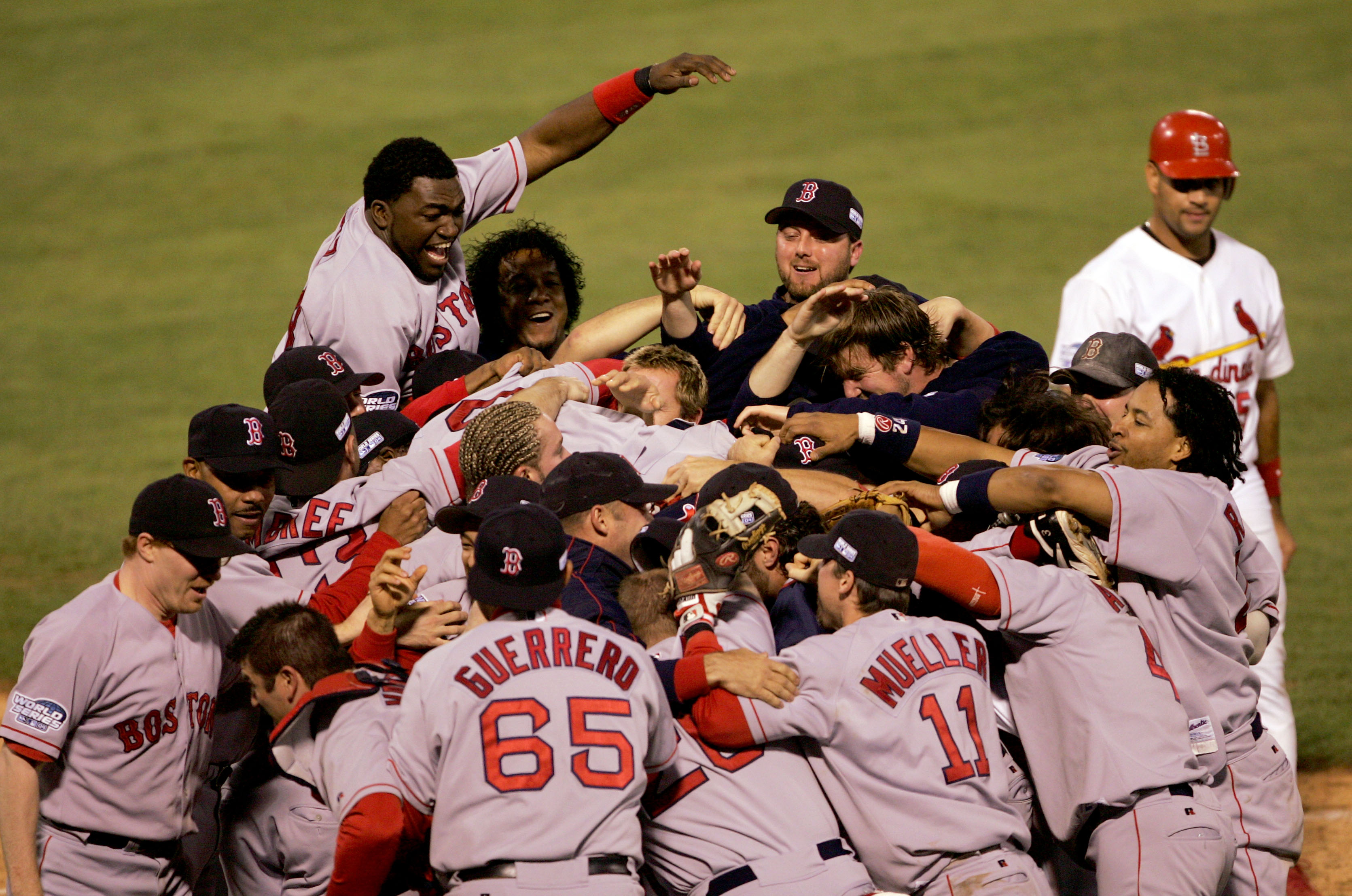 ST LOUIS - OCTOBER 27:  The Boston Red Sox celebrate after defeating the St. Louis Cardinals 3-0 to win game four of the World Series on October 27, 2004 at Busch Stadium in St. Louis, Missouri.  (Photo by Stephen Dunn/Getty Images)