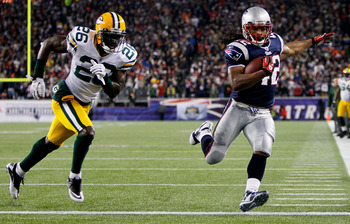 FOXBORO, MA - DECEMBER 19:  Running back BenJarvus Green-Ellis #42 of the New England Patriots runs 33 yards to score a touchdown in the first quarter against safety Charlie Peprah #26 of the Green Bay Packers at Gillette Stadium on December 19, 2010 in F