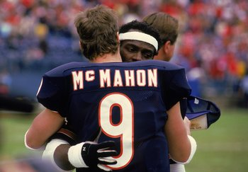 Walter Payton #34 of the Chicago Bears hugs Quarterback Jim McMahon #9 after a game.