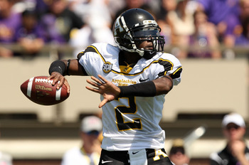 GREENVILLE, NC - SEPTEMBER 05:  DeAndre Presley #2 of the Appalachian State Mountaineers drops back to throw a pass against the East Carolina Pirates at Dowdy-Ficklen Stadium on September 5, 2009 in Greenville, North Carolina.  (Photo by Streeter Lecka/Ge