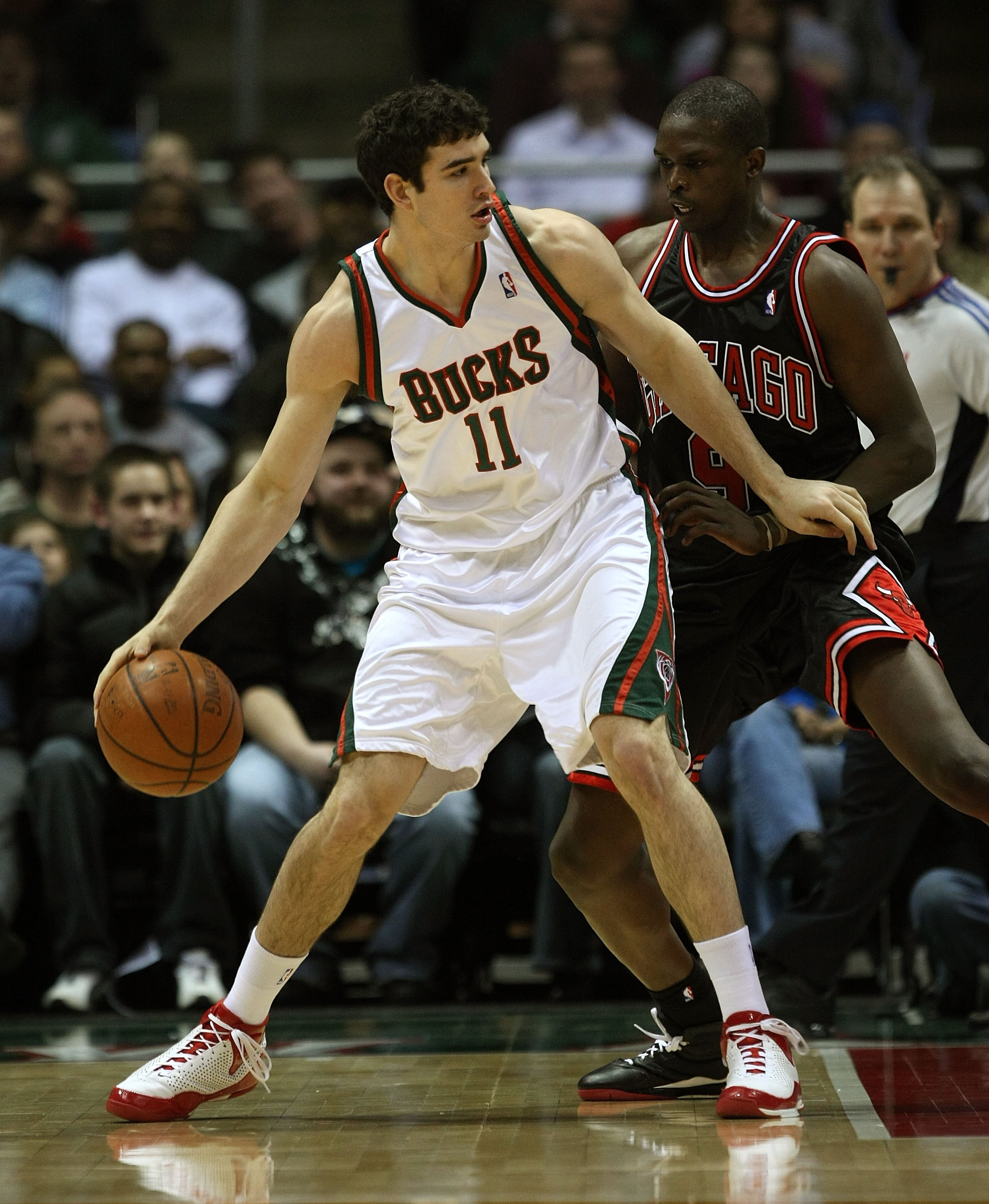 MILWAUKEE - FEBRUARY 18: Joe Alexander #11 of the Milwaukee Bucks moves against Loul Deng #9 of the Chicago Bulls on February 18, 2009 at the Bradley Center in Milwaukee, Wisconsin. The Bulls defeated the Bucks 133-104. NOTE TO USER: User expressly acknow
