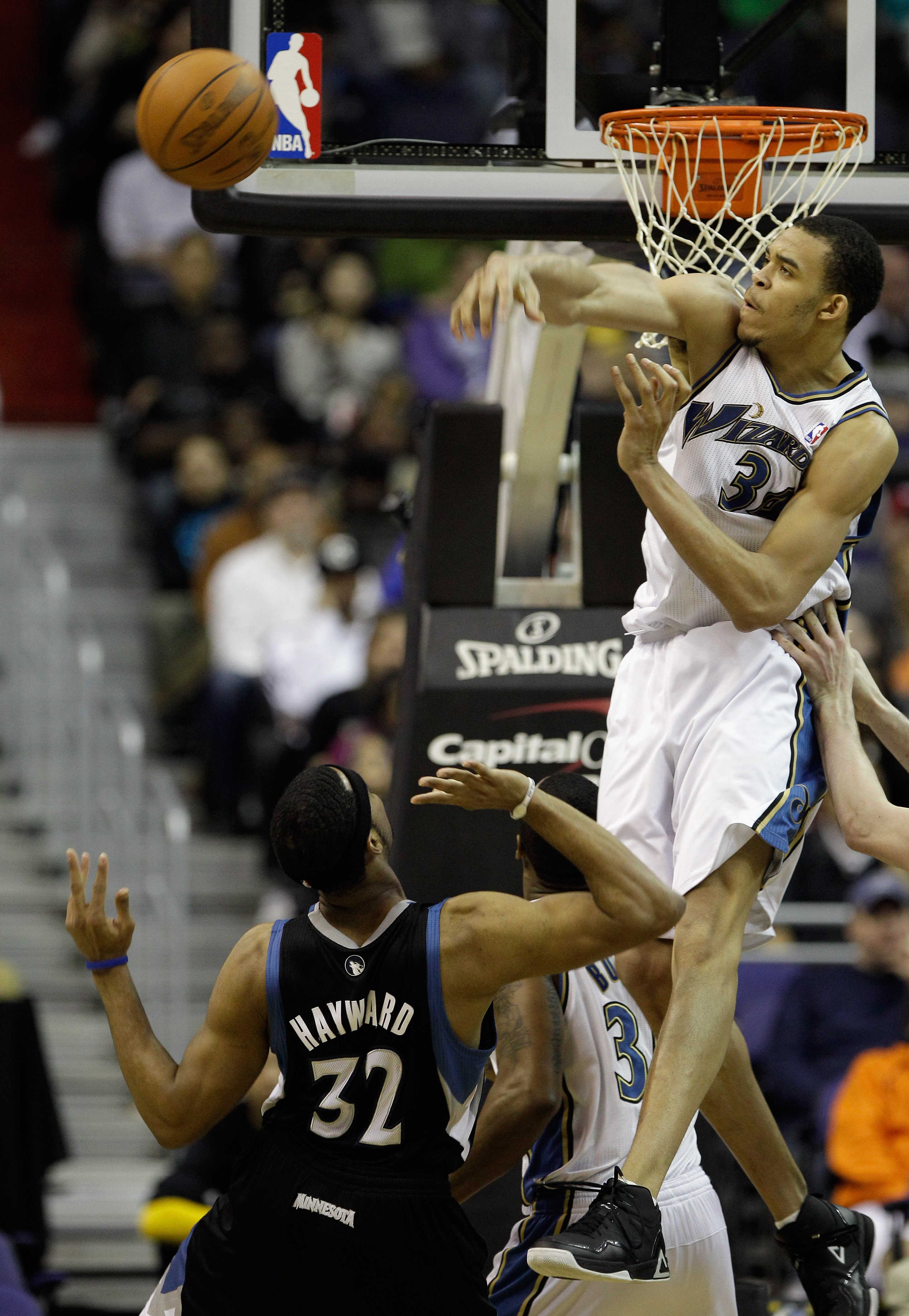 WASHINGTON, DC - MARCH 05:  JaVale McGee #34 of the Washington Wizards blocks a shot by Lazar Hayward #32 of the Minnesota Timberwolves at the Verizon Center on March 5, 2011 in Washington, DC. NOTE TO USER: User expressly acknowledges and agrees that, by