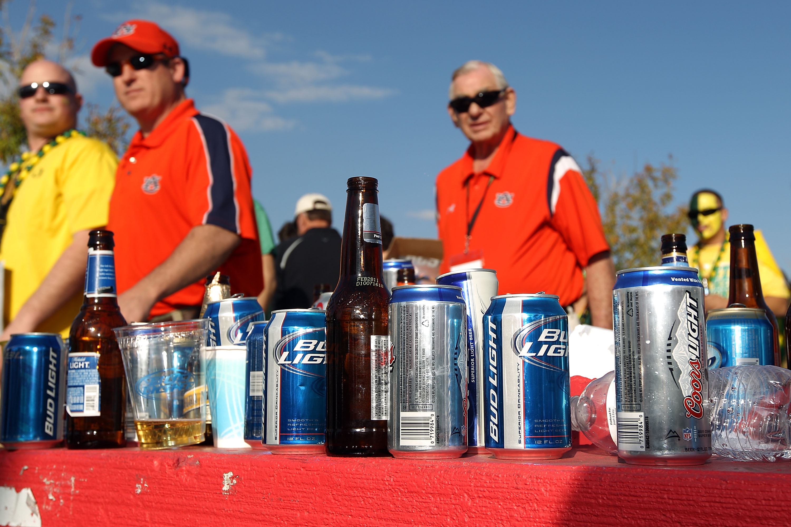 GLENDALE, AZ - JANUARY 10:  Fans walk by the alcohol collection table before the Tostitos BCS National Championship Game between the Oregon Ducks and the Auburn Tigers at University of Phoenix Stadium on January 10, 2011 in Glendale, Arizona.  (Photo by C