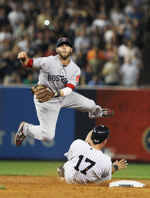 NEW YORK, NY - JUNE 08:  Dustin Pedroia #15 of the Boston Red Sox turns a double play as Francisco Cervelli #17 of the New York Yankees slides into second base during their game on June 8, 2011 at Yankee Stadium in the Bronx borough of New York City.  (Ph