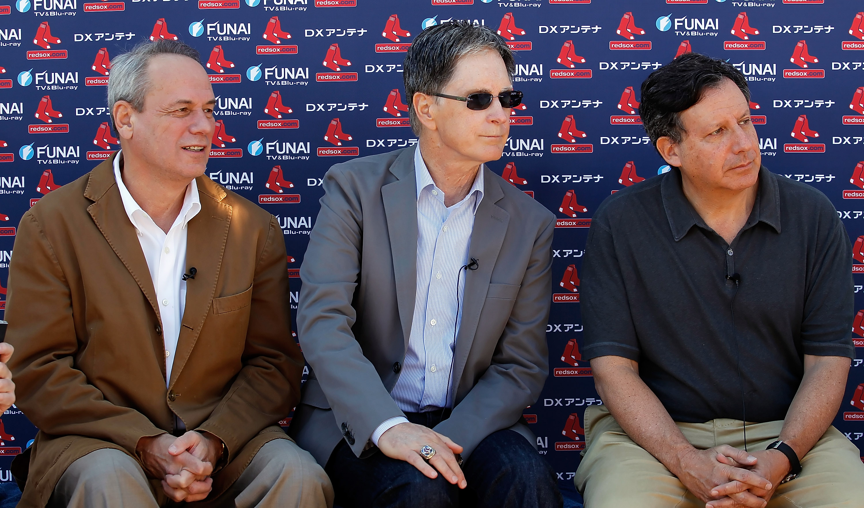 FORT MYERS, FL - FEBRUARY 19:  (L-R) President/CEO Larry Lucchino, Principal Owner John Henry and Chairman Tom Werner of the Boston Red Sox talk with the media during a Spring Training Workout Session at the Red Sox Player Development Complex on February