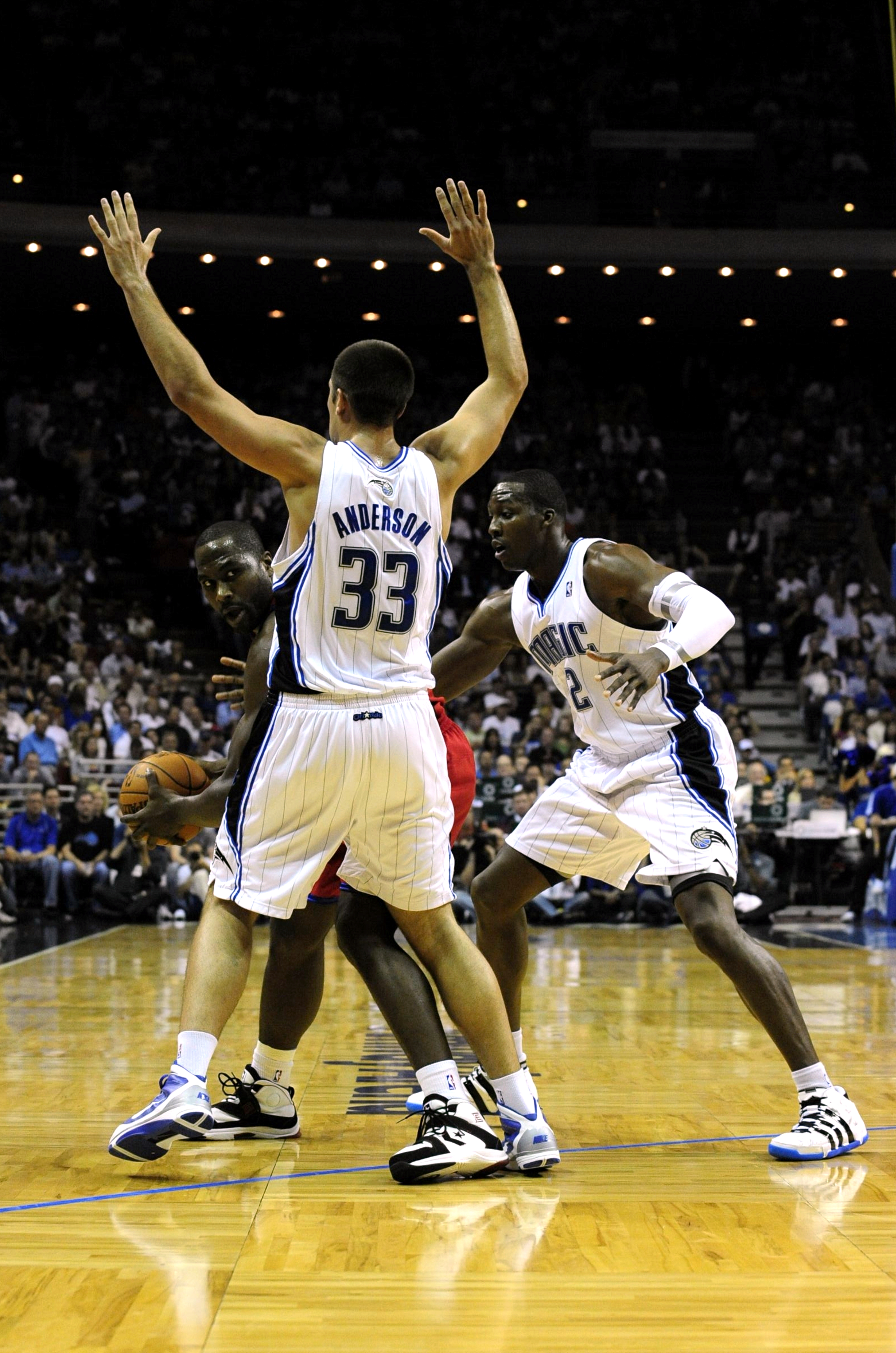 ORLANDO, FL - OCTOBER 28:  Elton Brand #42 of the Philadelphia 76ers looks for an open pass around Ryan Anderson #33 and Mickael Pietrus #20 of the Orlando Magic during the game on October 28, 2009 at Amway Arena in Orlando, Florida.  NOTE TO USER: User e