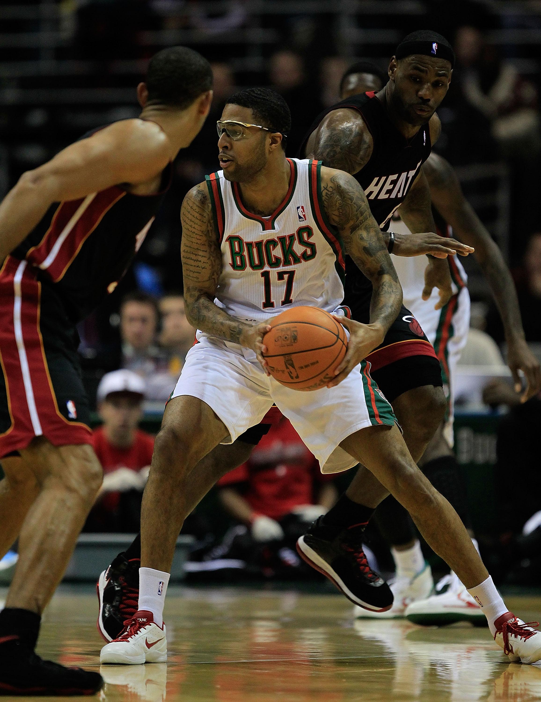 MILWAUKEE, WI - DECEMBER 06: Chris Douglas-Roberts #17 of the Milwaukee Bucks looks to pass between Juwan Howard #5 and LeBron James #6 of the Miami Heat at the Bradley Center on December 6, 2010 in Milwaukee, Wisconsin. The Heat defeated the Bucks 88-78.