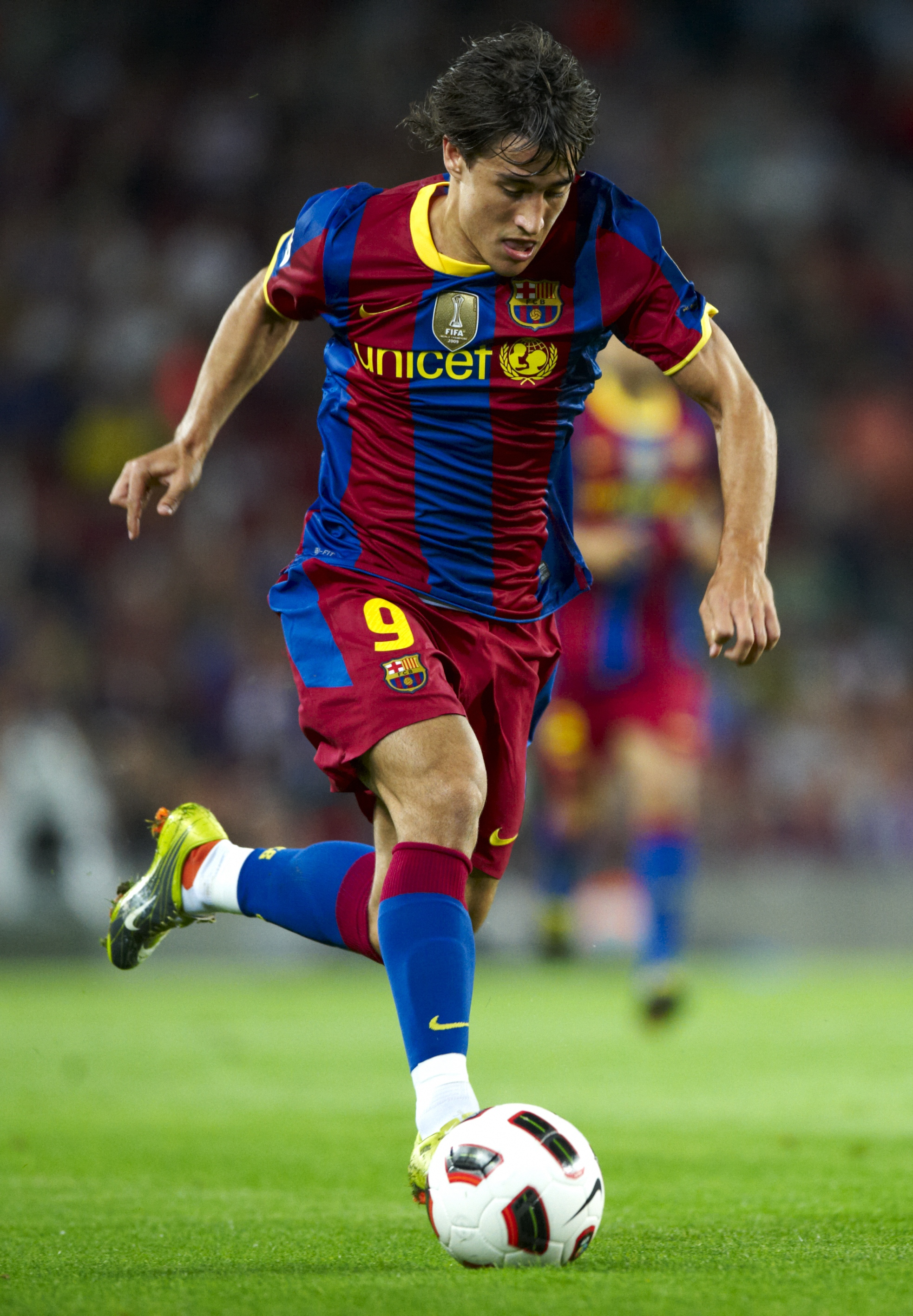 BARCELONA, SPAIN - SEPTEMBER 22:  Bojan Krkic of FC Barcelona runs with the ball during the La Liga match between Barcelona and Sporting de Gijon at Nou Camp on September 22, 2010 in Barcelona, Spain. Barcelona won 1-0.  (Photo by Manuel Queimadelos Alons