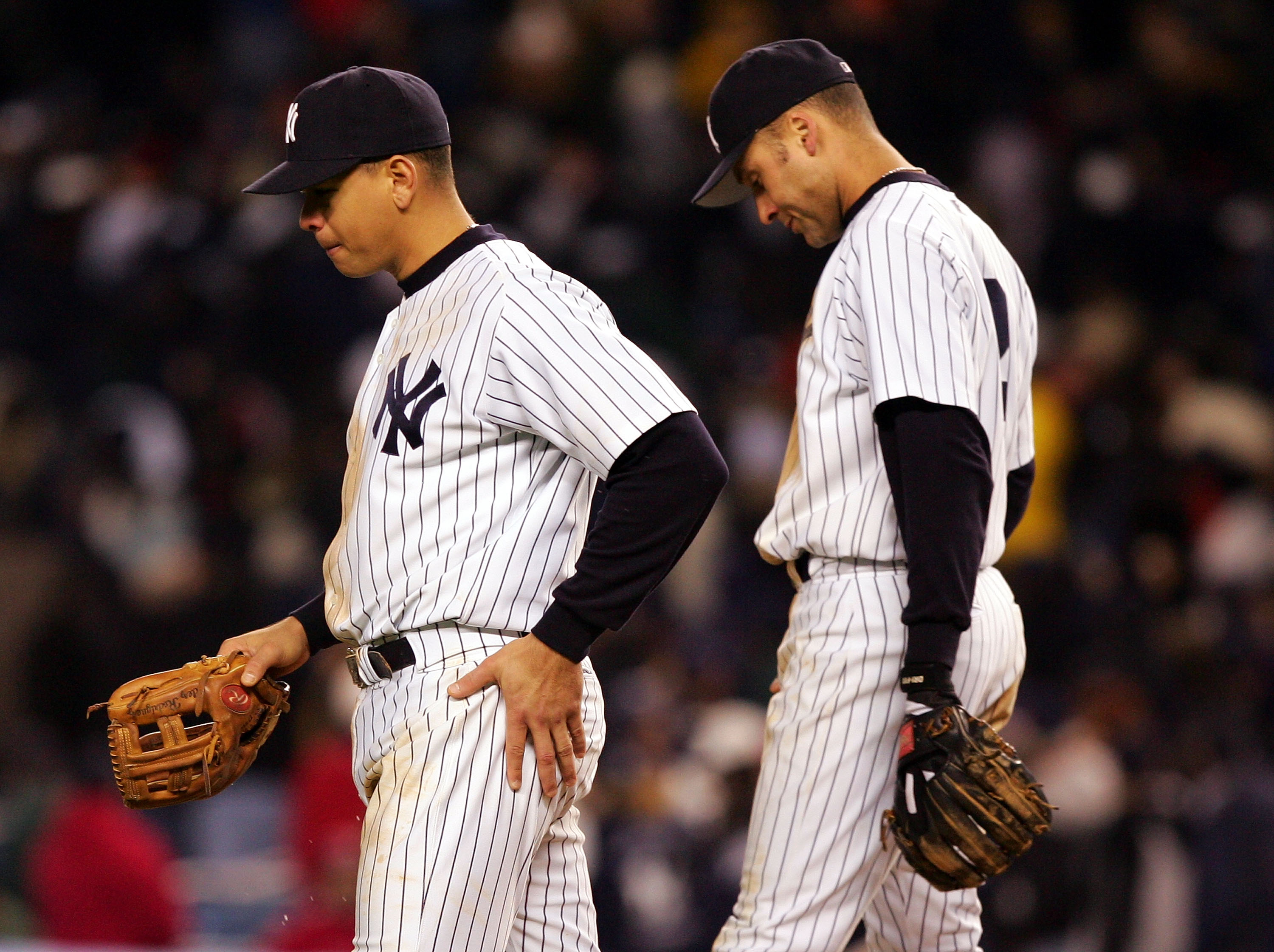 NEW YORK - OCTOBER 20:  Alex Rodriguez #13 and Derek Jeter #2 of the New York Yankees walk back to the dugout after the end of the eighth inning against the Boston Red Sox during game seven of the American League Championship Series on October 20, 2004 at