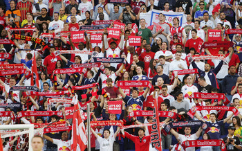 HARRISON, NJ - MARCH 20:  Fans cheer as the New York Red Bulls play the Santos FC on March 20, 2010 at Red Bull Arena in Harrison, New Jersey.  (Photo by Chris Trotman/Getty Images for New York Red Bulls)