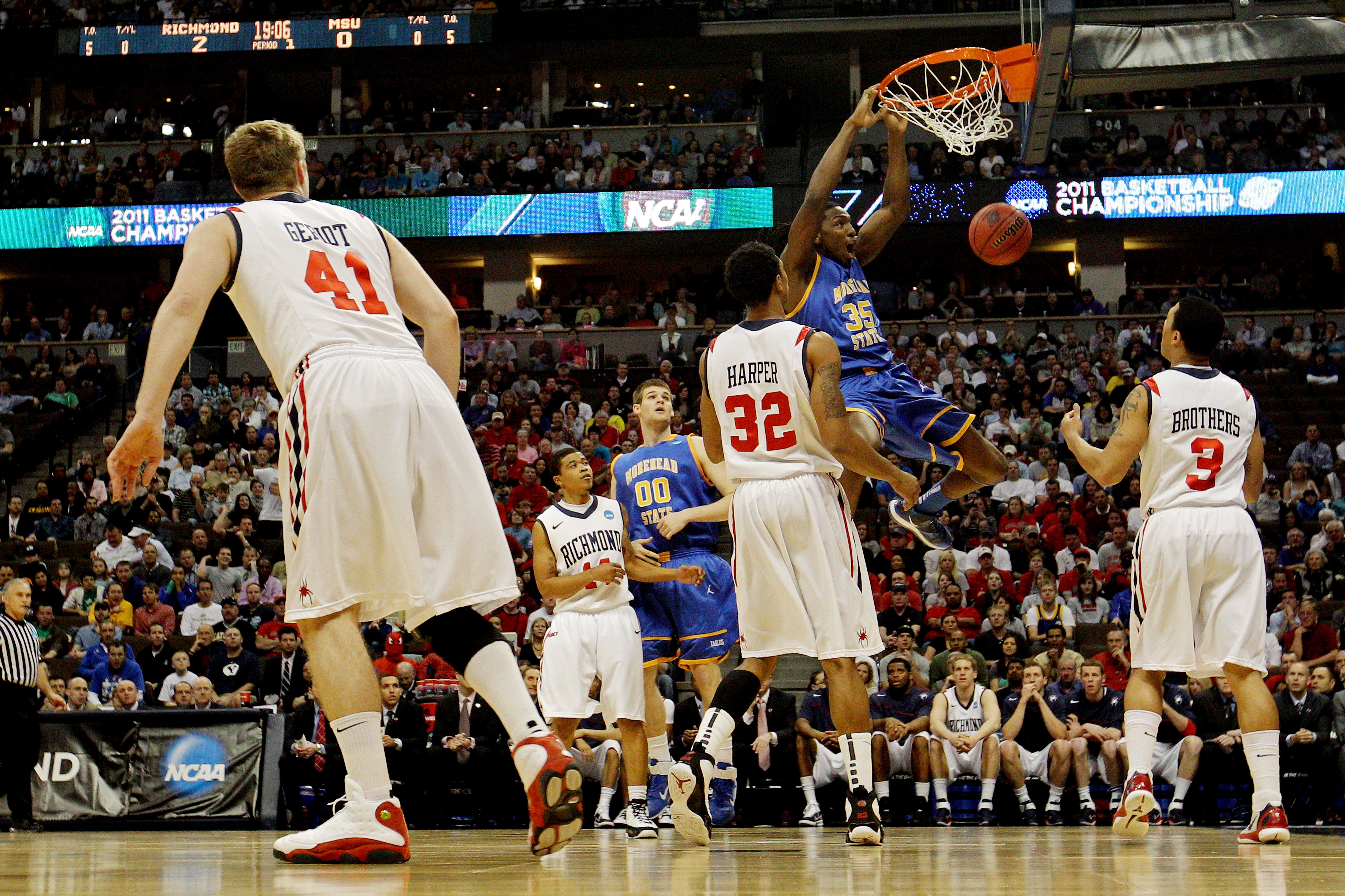 DENVER, CO - MARCH 19:  Kenneth Faried #35 of the Morehead State Eagles dunks the ball against Justin Harper #32 and Darien Brothers #3 of the Richmond Spiders during the third round of the 2011 NCAA men's basketball tournament at Pepsi Center on March 19
