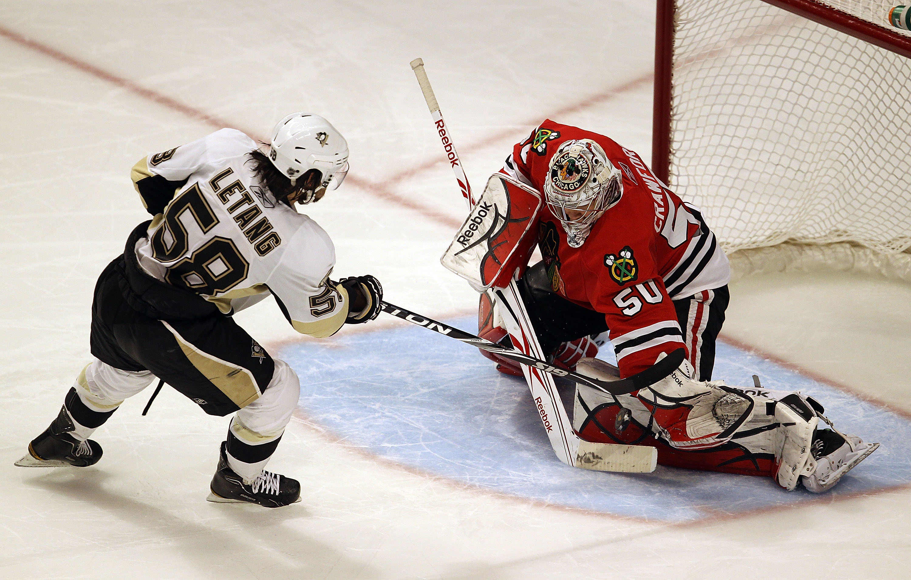 CHICAGO, IL - FEBRUARY 20: Corey Crawford #50 of the Chicago Blackhawks makes a save against Kris Letang #58 of the Pittsburgh Penguins during the shootout at the United Center on February 20, 2011 in Chicago, Illinois. The Blackhawks defeated the Penguin