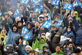 SEATTLE - DECEMBER 23: Fans of the Seattle Seahawks hold up the 12th man signs during the game against the Baltimore Ravens at Qwest Field on December 23, 2007 in Seattle, Washington. The Seahawks defeated the Ravens 27-6. (Photo by Otto Greule Jr/Getty I