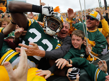 GREEN BAY, WI - SEPTEMBER 19: Brandon Jackson #32 of the Green Bay Packers celebrates a touchdown with a 'Lambeau Leap' into the stands against of the Buffalo Bills at Lambeau Field on September 19, 2010 in Green Bay, Wisconsin. The Packers defeated the B