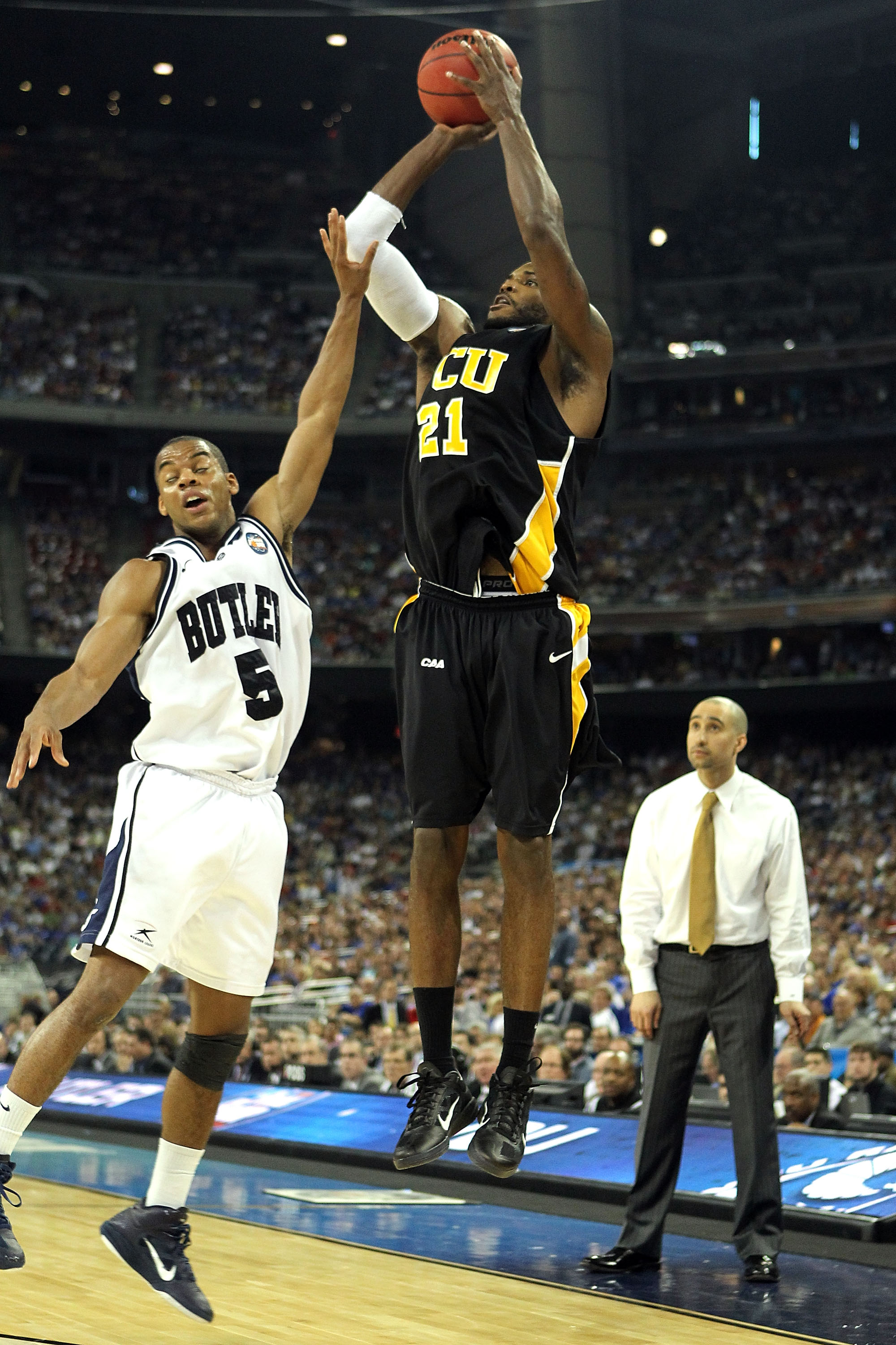 HOUSTON, TX - APRIL 02:  Jamie Skeen #21 of the Virginia Commonwealth Rams shoots the ball over Ronald Nored #5 of the Butler Bulldogs during the National Semifinal game of the 2011 NCAA Division I Men's Basketball Championship at Reliant Stadium on April