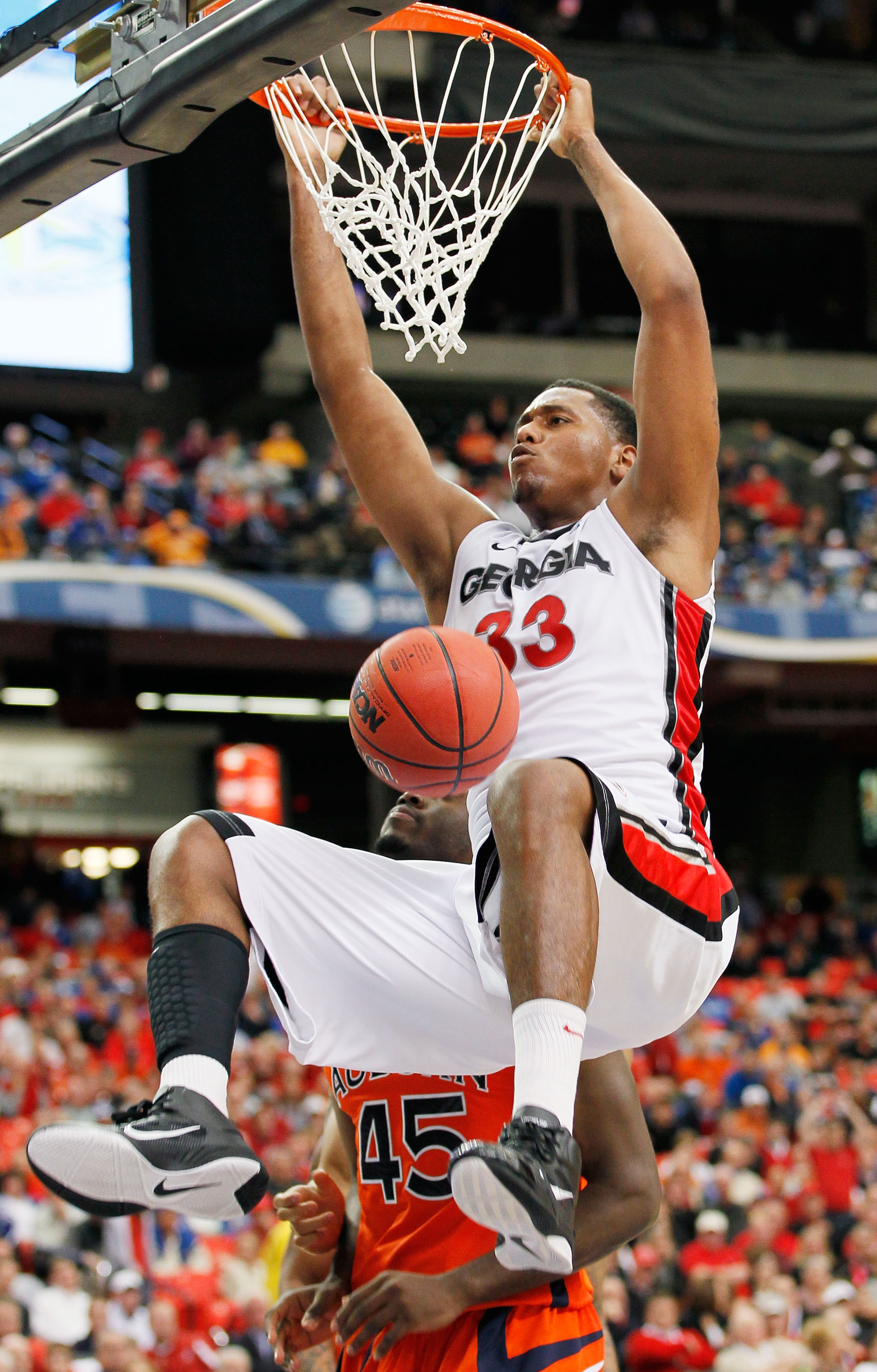 ATLANTA, GA - MARCH 10:  Trey Thompkins #33 of the Georgia Bulldogs dunks against the Auburn Tigers during the first round of the SEC Men's Basketball Tournament at the Georgia Dome on March 10, 2011 in Atlanta, Georgia.  (Photo by Kevin C. Cox/Getty Imag