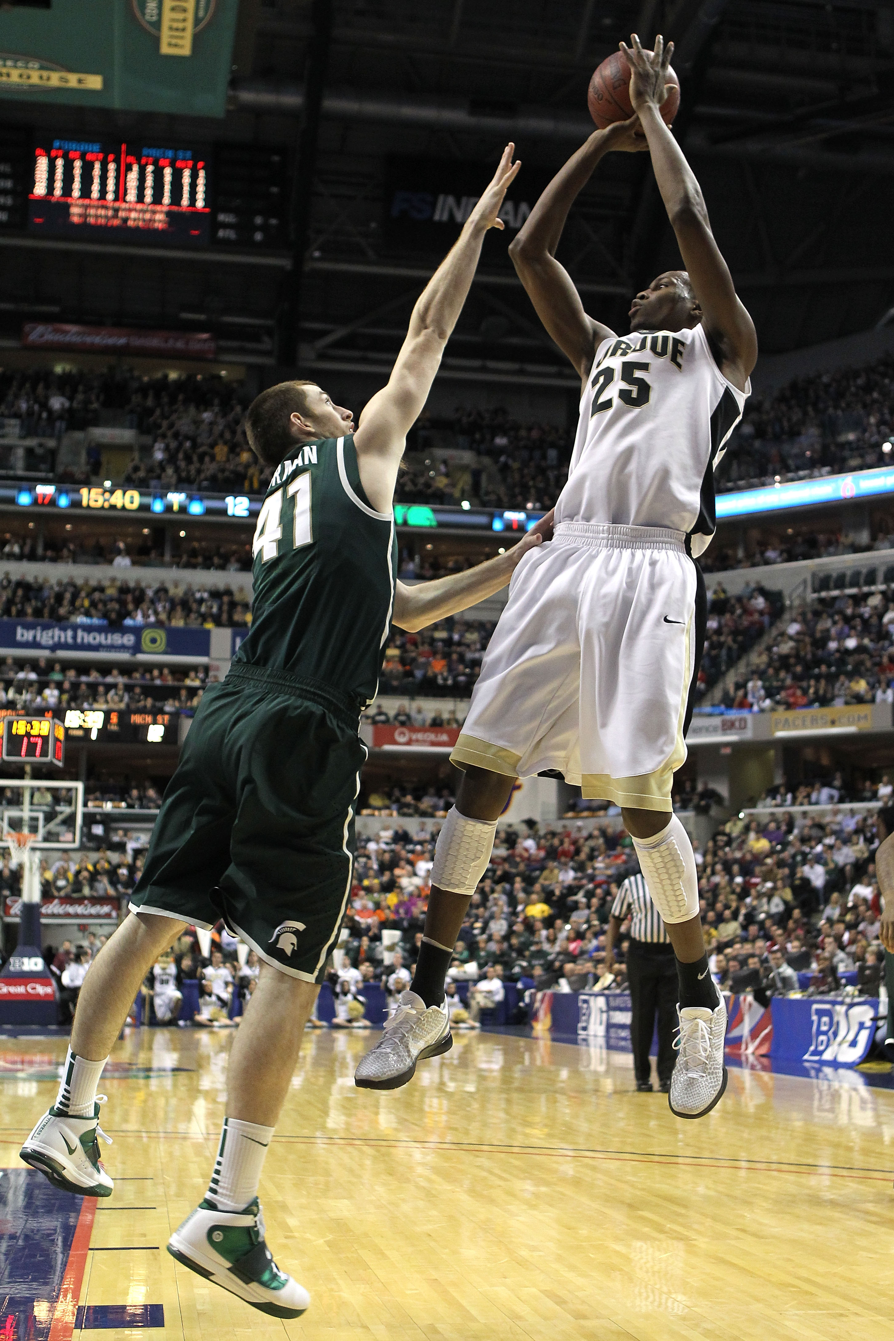 INDIANAPOLIS, IN - MARCH 11:  JaJuan Johnson #25 of the Purdue Boilermakers attempts a shot against Garrick Sherman #41 of the Michigan State Spartans during the quarterfinals of the 2011 Big Ten Men's Basketball Tournament at Conseco Fieldhouse on March