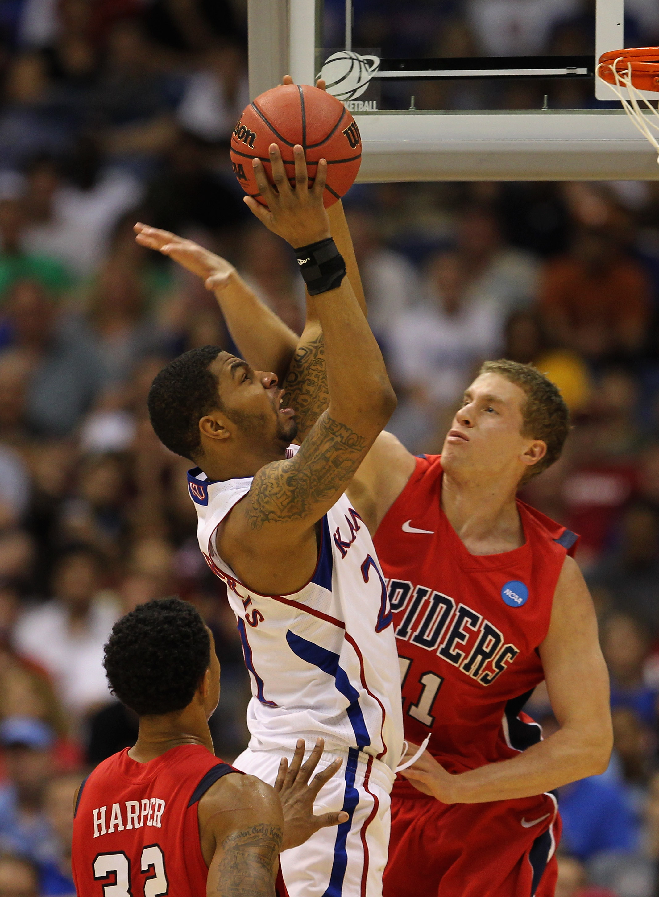 SAN ANTONIO, TX - MARCH 25:  Markieff Morris #21 of the Kansas Jayhawks goes to the basket against Josh Duinker #11 of the Richmond Spiders during the southwest regional of the 2011 NCAA men's basketball tournament at the Alamodome on March 25, 2011 in Sa