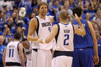 DALLAS, TX - MAY 25:  Dirk Nowitzki #41 and Jason Kidd #2 of the Dallas Mavericks celebrate late in the fourth quarter while taking on the Oklahoma City Thunder in Game Five of the Western Conference Finals during the 2011 NBA Playoffs at American Airline