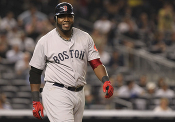 NEW YORK, NY - JUNE 09:  David Ortiz #34 of the Boston Red Sox smiles after he walks to first after being hit by a pitch against the New York Yankees on June 9, 2011 at Yankee Stadium in the Bronx borough of New York City.  (Photo by Nick Laham/Getty Imag