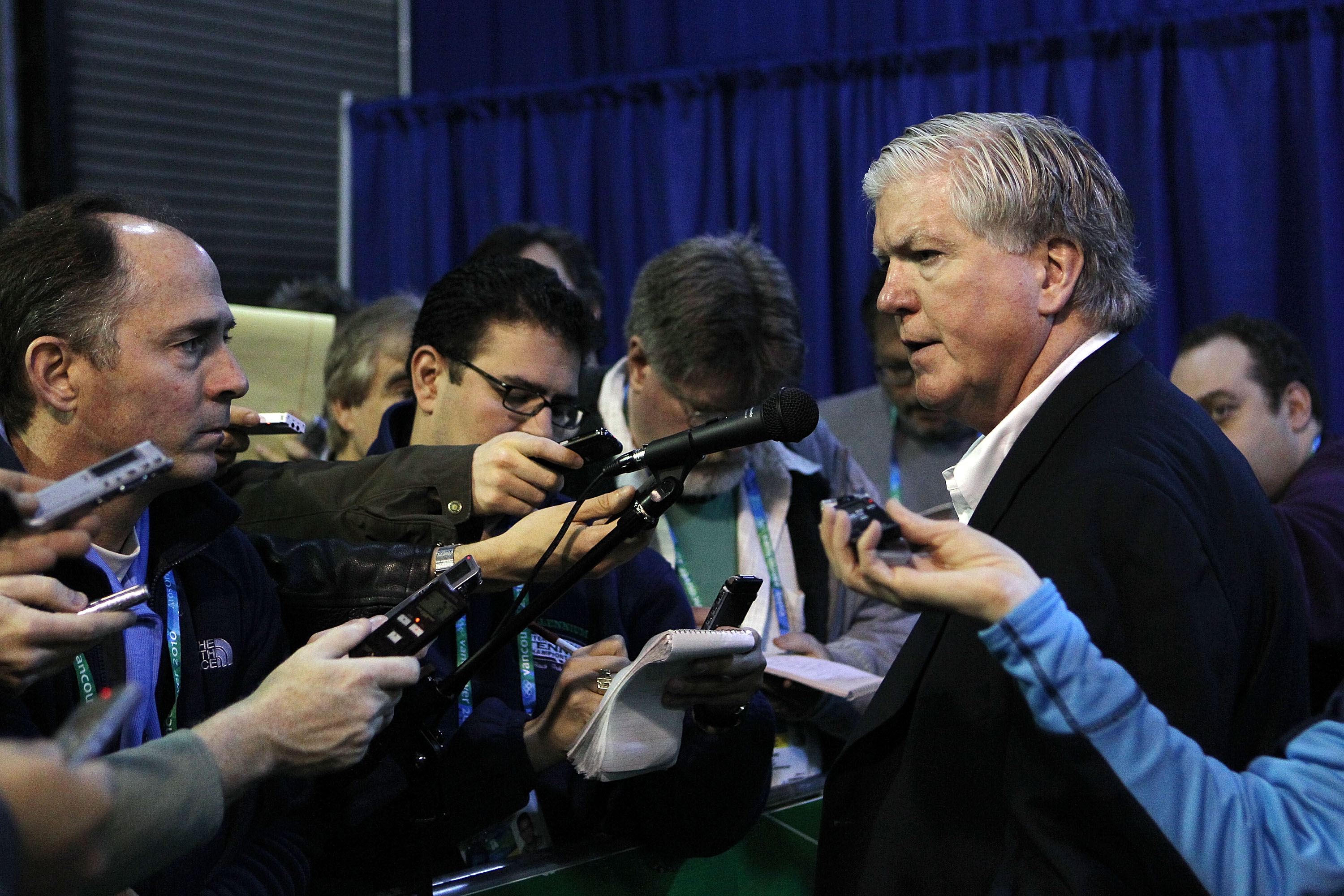 VANCOUVER, BC - FEBRUARY 22:  Hockey USA General Manager and Toronto Maple Leafs GM Brian Burke (R) speaks to the media prior to the start of the Women's USA vs. Sweden  women's semifinal game on day 11 of the Vancouver 2010 Winter Olympics at Canada Hock