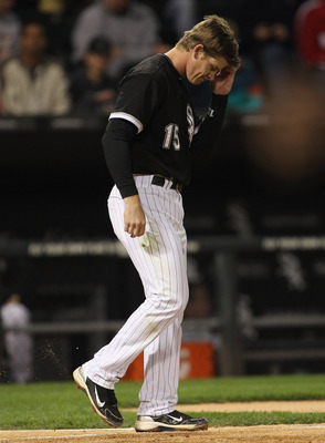 CHICAGO, IL - MAY 16: Gordon Beckham #15 of the Chicago White Sox reacts after striking out to end an inning against the Texas Rangers at U.S. Cellular Field on May 16, 2011 in Chicago, Illinois. The Rangers defeated the White Sox 4-0. (Photo by Jonathan