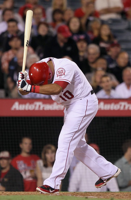 ANAHEIM, CA - JUNE 08:  Vernon Wells #10 of the Los Angeles Angels of Anaheim reacts after striking out in the eighth inning against the Tampa Bay Rays at Angel Stadium of Anaheim on June 8, 2011 in Anaheim, California. The Rays defeated the Angels 4-3 in