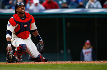 CLEVELAND - APRIL 17:  Carlos Santana #41 of the Cleveland Indians grimaces after being hit by a pitch during the game against the Baltimore Orioles on April 17, 2011 at Progressive Field in Cleveland, Ohio.  (Photo by Jared Wickerham/Getty Images)