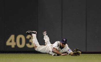 MINNEAPOLIS, MN - JUNE 9: Ben Revere #11 of the Minnesota Twins dives for a ball hit into play by the Texas Rangers during the eighth inning of their game on June 9, 2011 at Target Field in Minneapolis, Minnesota. Twins defeated the Rangers 5-4. (Photo by