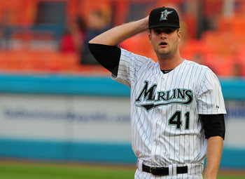 MIAMI GARDENS, FL - JUNE 09:  Pitcher Chris Volstad #41 0f the Florida Marlins Reacts after giving up a double to the Atlanta Braves at Sun Life Stadium on June 9, 2011 in Miami Gardens, Florida.  (Photo by Marc Serota/Getty Images)