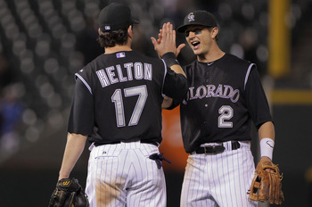 DENVER, CO - JUNE 09:  Todd Helton #17 and Troy Tulowitzki #2 of the Colorado Rockies celebrate their 9-7 victory over the Los Angeles Dodgers at Coors Field on June 9, 2011 in Denver, Colorado.  (Photo by Doug Pensinger/Getty Images)