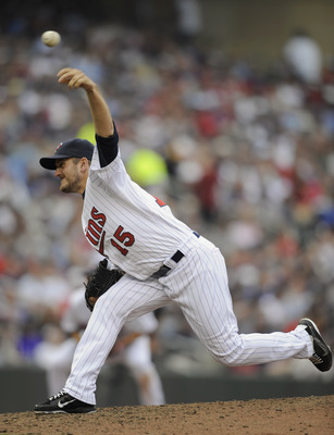 MINNEAPOLIS, MN - APRIL 10: Glen Perkins #15 of the Minnesota Twins pitches against the Oakland Athletics during the sixth inning of their game on April 10, 2011 at Target Field in Minneapolis, Minnesota. Athletics defeated the Twins 5-3. (Photo by Hannah
