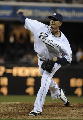 SAN DIEGO, CA-JUNE 3: Mike Adams #37 of the San Diego Padres pitches during the seventh inning of a baseball game against the Houston Astros at Petco Park on June 3, 2011 in San Diego, California.  (Photo by Denis Poroy/Getty Images)