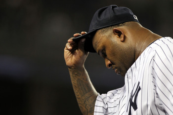 NEW YORK, NY - JUNE 09:  CC Sabathia #52 of the New York Yankees is pulled from the game in the seventh inning against the Boston Red Sox on June 9, 2011 at Yankee Stadium in the Bronx borough of New York City.  (Photo by Nick Laham/Getty Images)