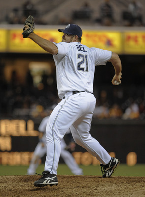 SAN DIEGO, CA-JUNE 3: Heath Bell #21 of the San Diego Padres pitches during the ninth inning of a baseball game against the Houston Astros at Petco Park on June 3, 2011 in San Diego, California.  (Photo by Denis Poroy/Getty Images)