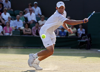 LONDON, ENGLAND - JUNE 28:  Andy Roddick of USA plays a shot during his match against Yen-Hsun Lu of Taipei on Day Seven of the Wimbledon Lawn Tennis Championships at the All England Lawn Tennis and Croquet Club on June 28, 2010 in London, England.  (Phot