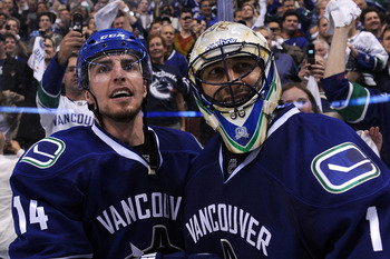 VANCOUVER, BC - MAY 24:  Alex Burrows #14 and goaltender Roberto Luongo #1 of the Vancouver Canucks celebrate after defeating the San Jose Sharks 3-2 in double-overtime in Game Five to win the Western Conference Finals 4-1 during the 2011 Stanley Cup Play