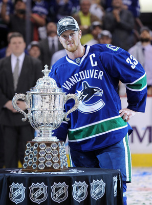 VANCOUVER, CANADA - MAY 24:  Captain Henrik Sedin #33 of the Vancouver Canucks poses with the Clarence Campbell Trophy after the Vancouver Canucks defeated the San Jose Sharks 3-2 in double-overtime in Game Five to win the Western Conference Finals during