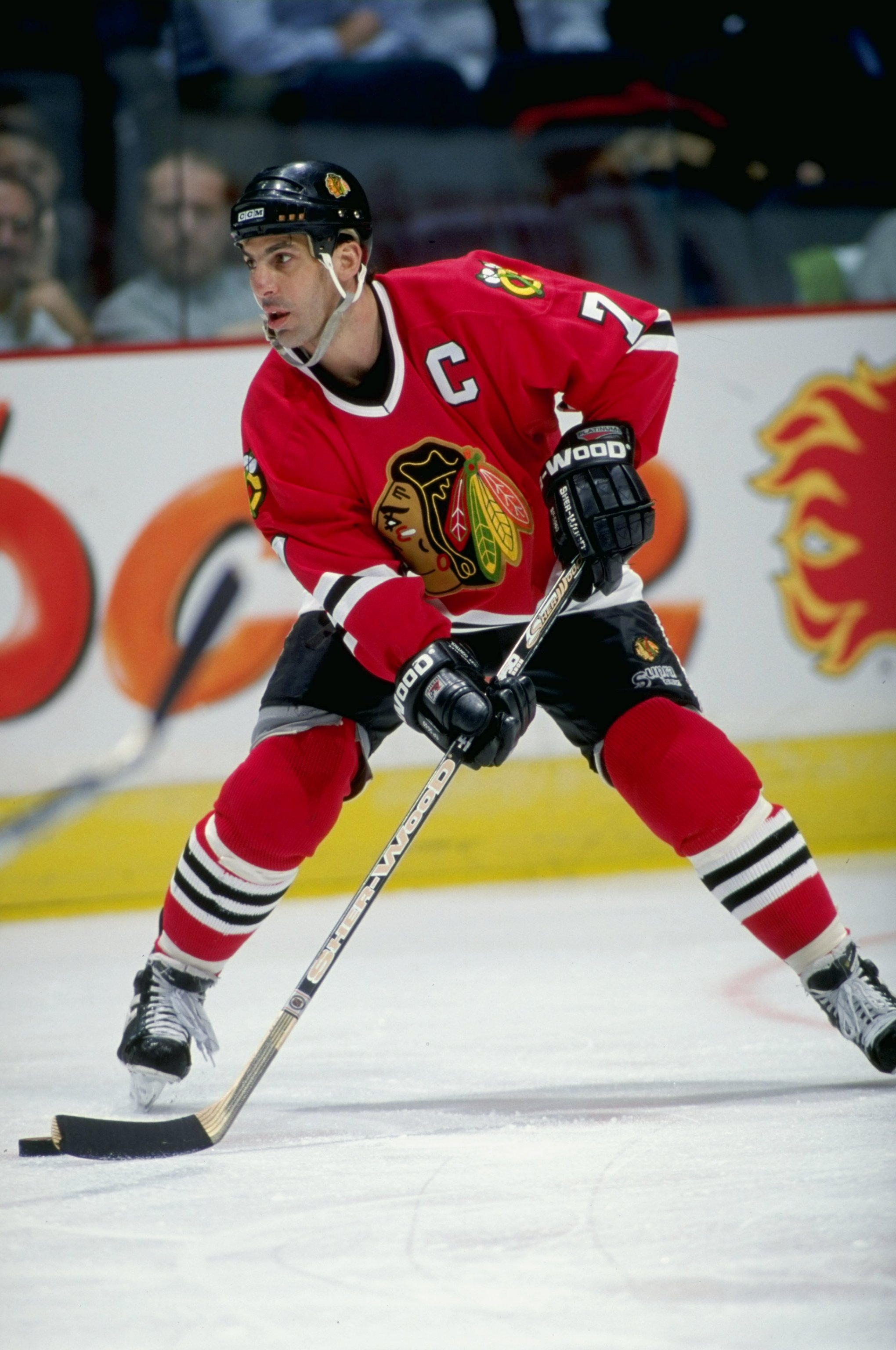 28 Jan 1999:  Chris Chelios #7 of the Chicago Blackhawks controls the puck during the game against the Calgary Flames at the Canadian Airlines Saddledome in Calgary, Alberta, Canada. The Blackhawks tied the Flames 6-6. Mandatory Credit: Ian Tomlinson  /Al