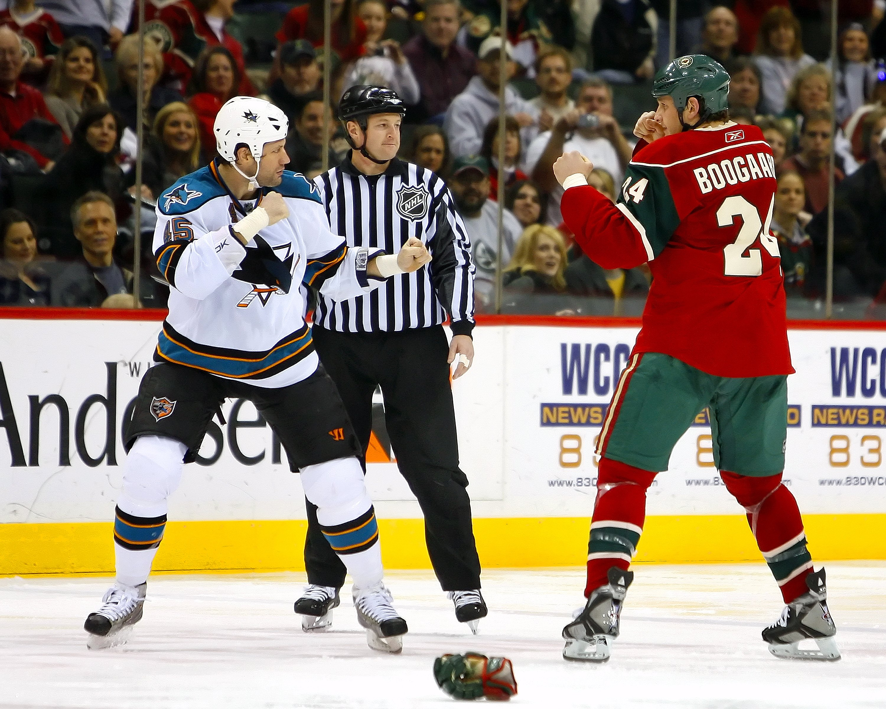 ST. PAUL, MN - DECEMBER 31:  Jody Shelley #45 of the San Jose Sharks and Derek Boogaard #24 of the Minnesota Wild square off to fight December 31, 2008 at the Xcel Energy Center in St. Paul, Minnesota. (Photo by Scott A. Schneider/Getty Images)