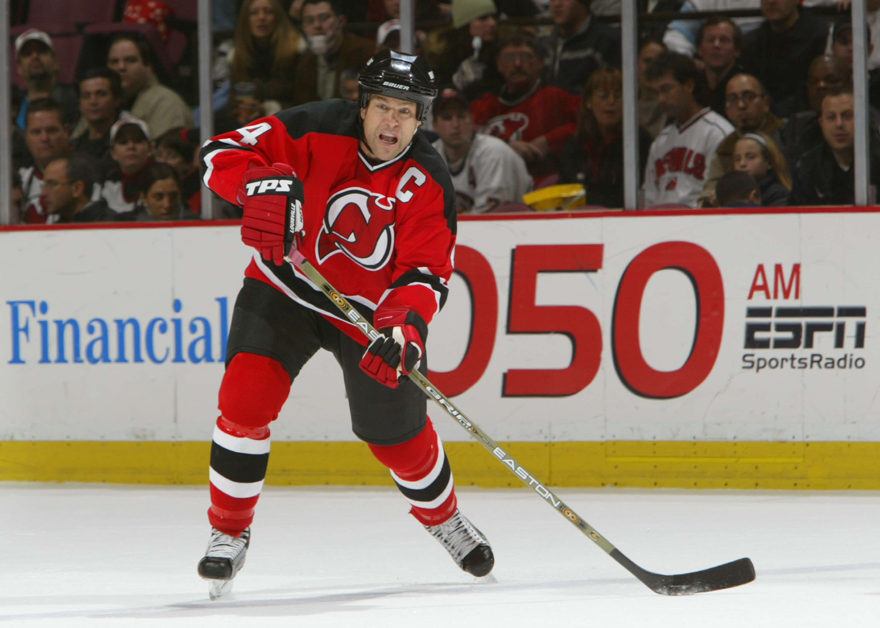 EAST RUTHERFORD, NJ - DECEMBER 10:  Defenseman Scott Stevens #4 of the New Jersey Devils shoots during the game against the New York Islanders on December 10, 2003 at Continental Airlines Arena in East Rutherford, New Jersey. The Devils won 1-0. (Photo by