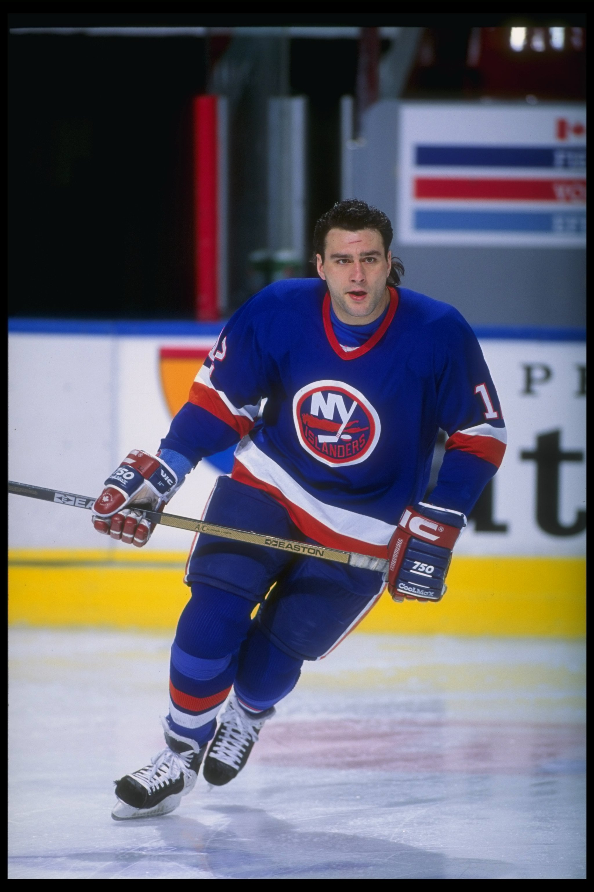 Rightwinger Marty McInnis of the New York Islanders moves down the ice during a game against the Quebec Nordiques at the Quebec Coliseum in Quebec City, Quebec.