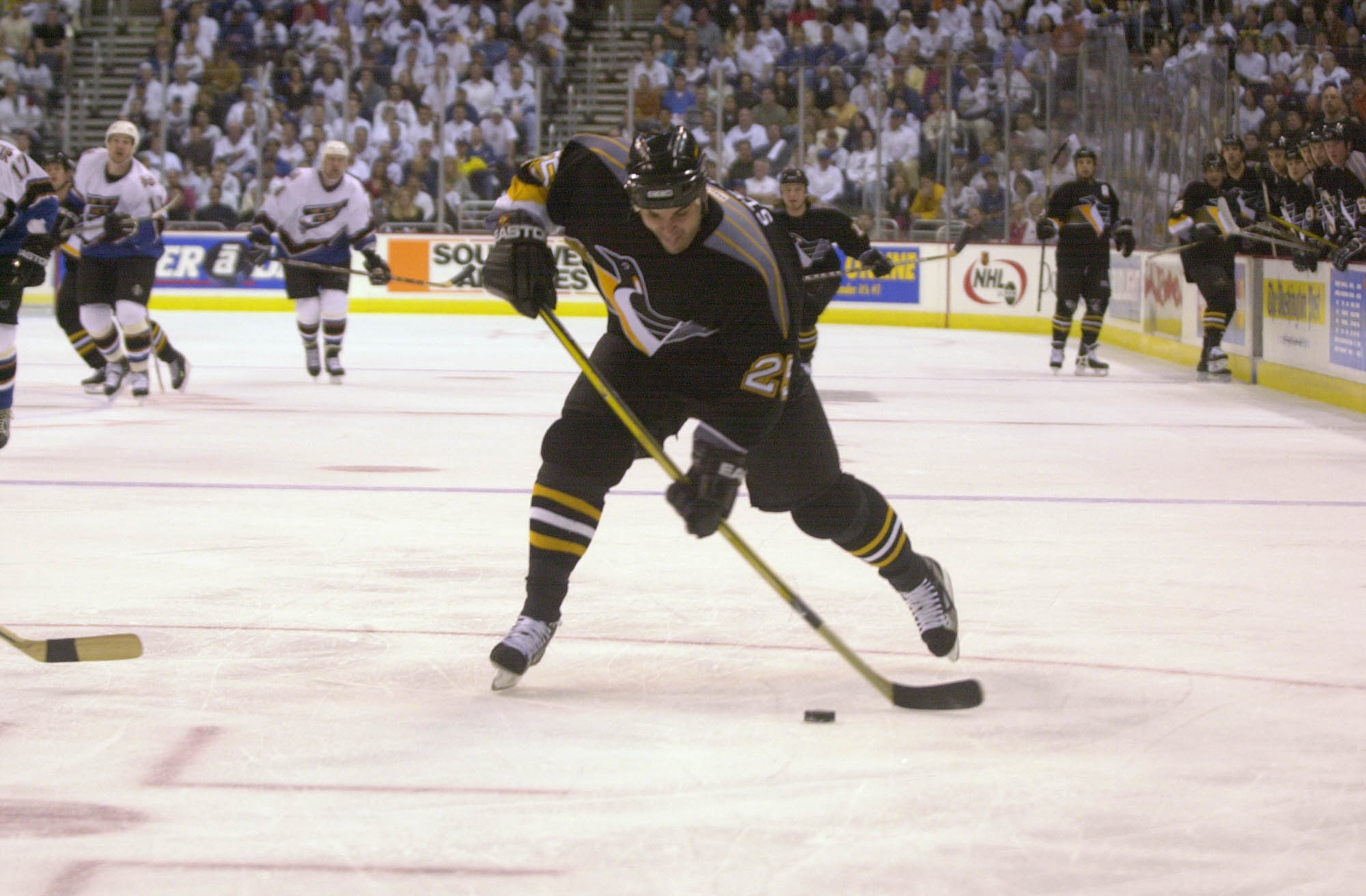 21 Apr 2001 : Kevin Stevens #25 of the Pittsburgh Penguins takes a shot against the Washington Capitals during Game 5 of the Eastern Conference Quarterfinals of the Stanley Cup Playoffs at MCI Center in Washington, DC . The Penguins defeat the Capitals 2-