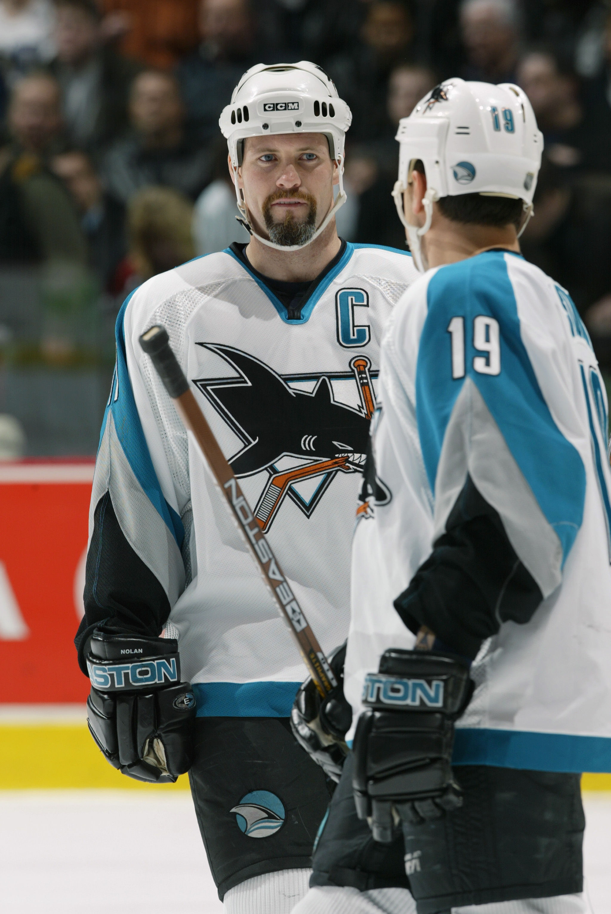 VANCOUVER - FEBRUARY 27:  Owen Nolan #11 of the San Jose Sharks talks with teammate Marco Sturm #19 during the NHL game against the Vancouver Canucks at General Motors Place on February 27, 2003 in Vancouver, Canada.  The Sharks won 3-2 .  (Photo by Jeff