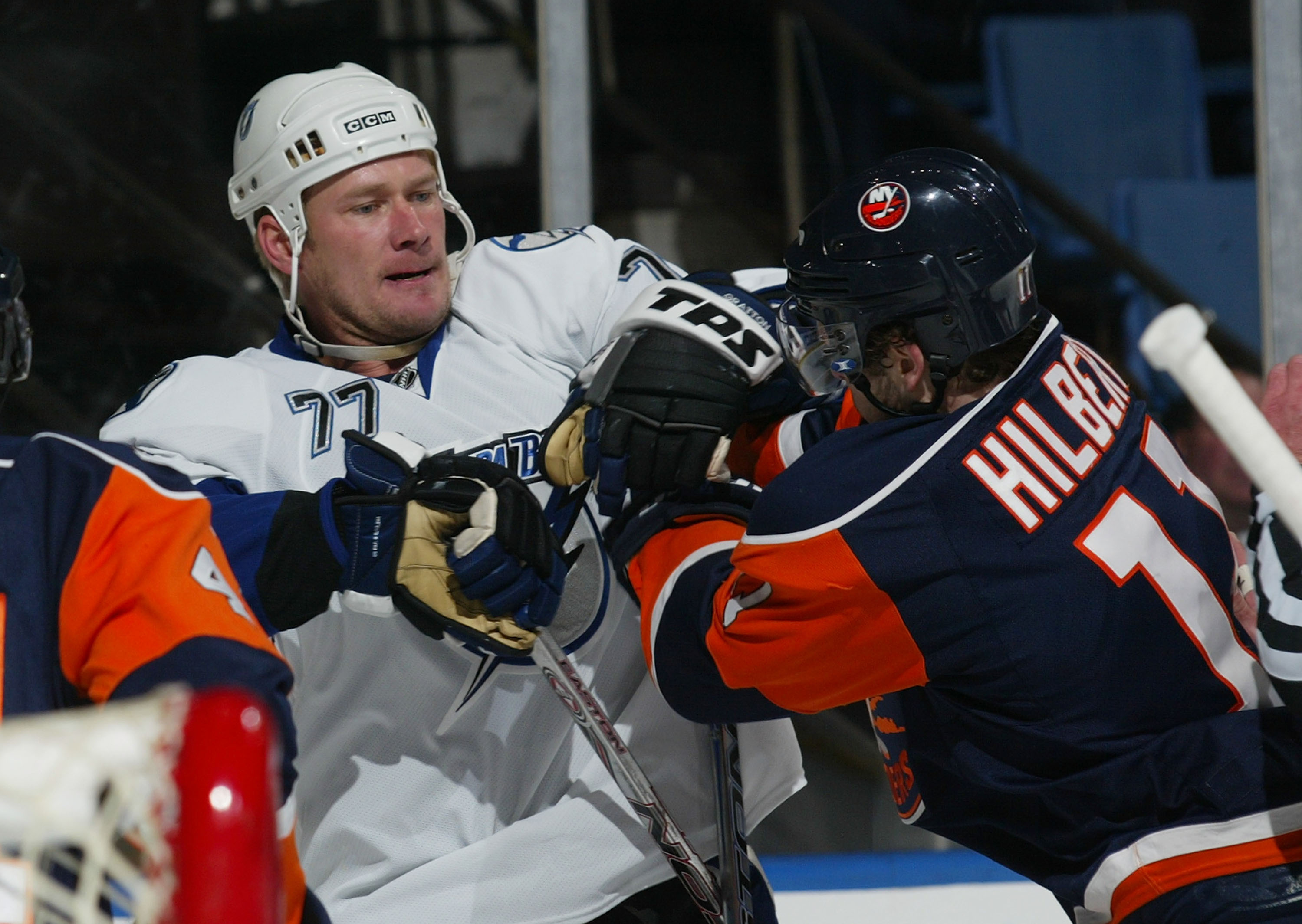 UNIONDALE, NY - FEBRUARY 21: Chris Gratton #77 of the Tampa Bay Lightning is pushed out of the crease by Andy Hilbert #11 of the New York Islanders on February 21, 2008 at the Nassau Coliseum in Uniondale, New York.  (Photo by Bruce Bennett/Getty Images)