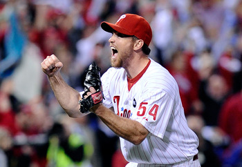 PHILADELPHIA - OCTOBER 21: Brad Lidge #54 of the Philadelphia Phillies celebrates defeating the Los Angeles Dodgers 10-4 to advance to the World Series in Game Five of the NLCS during the 2009 MLB Playoffs at Citizens Bank Park on October 21, 2009 in Phil
